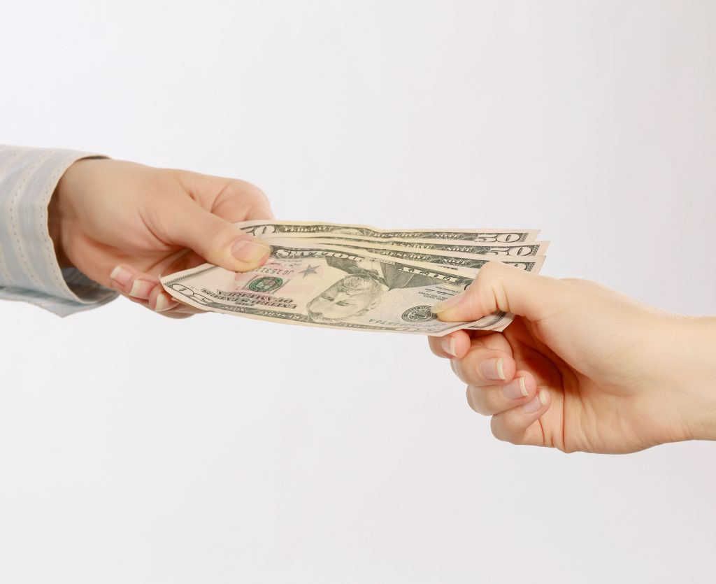 how do real estate agents get paid
